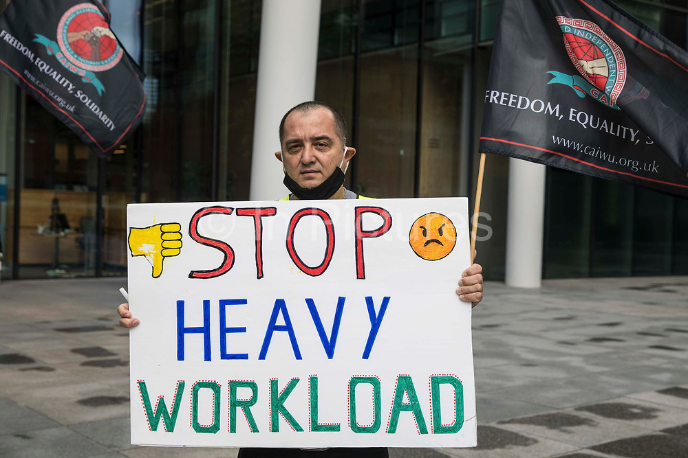 A night-shift cleaner belonging to the Cleaners and Allied Independent Workers Union CAIWU protests outside the UK headquarters of Facebook on 5th August 2021 in London, United Kingdom. Cleaners are outsourced via the Churchill Group to clean the Facebook offices and CAIWU claims that five additional floors have been added to their workload, that cleaners who have left have not been replaced and that sickness and holiday cover has not been provided.