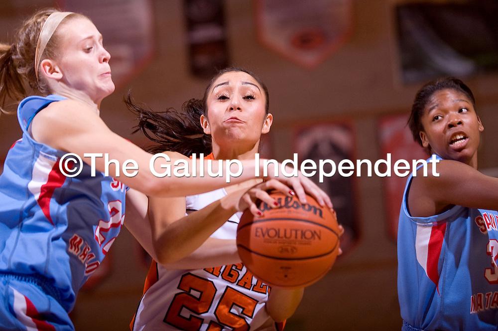 122212       Cable Hoover<br /> <br /> Gallup Bengal Rebecca Herrera (25) wrestles the ball away from Sandia Prep Matador Astrea Reed (22) Saturday at Gallup High School.