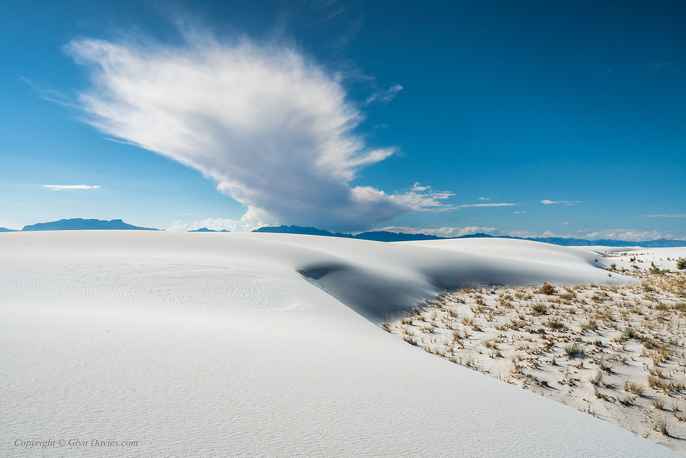 A vast cloud towers over the San Andreas mountains to the West of White Sands National Monument in New Mexico. These are to the South of the same White Sands National Monument where America carried out many of it's early nuclear weapons tests.