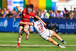 Karen Paquin of Canada is tackled by Kristi Kirshe of USA <br /> <br /> Photographer Craig Thomas/Replay Images<br /> <br /> World Rugby HSBC World Sevens Series - Day 2 - Friday 6rd December 2019 - Sevens Stadium - Dubai<br /> <br /> World Copyright © Replay Images . All rights reserved. info@replayimages.co.uk - http://replayimages.co.uk