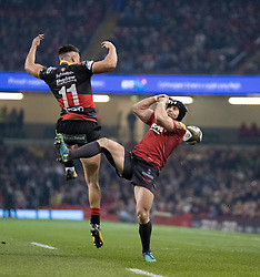 Dragons' Jared Rosser and Scarlets' Leigh Halfpenny vie for the high ball<br /> <br /> Photographer Simon King/Replay Images<br /> <br /> Guinness PRO14 Round 21 - Dragons v Scarlets - Saturday 28th April 2018 - Principality Stadium - Cardiff<br /> <br /> World Copyright © Replay Images . All rights reserved. info@replayimages.co.uk - http://replayimages.co.uk
