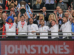 Peterborough United's captain Tommy Rowe lifts the Johnstone's Paint Trophy - Photo mandatory by-line: Joe Dent/JMP - Mobile: 07966 386802 30/03/2014 - SPORT - FOOTBALL - London - Wembley Stadium - Chesterfield United v Peterborough United - Johnstone Paint Trophy Final