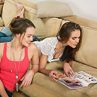 pictures in a living room of two young girls sitting on a couch