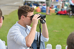RICHARD FLEESHMAN at the St.Regis International Polo Cup at Cowdray Park, Midhurst, West Sussex on 17th May 2014.