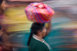 Abstract of people moving through Market at market day, Chichicastenango, Guatemala