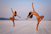 Two nude women posing at the Bonneville Salt Flats, Utah