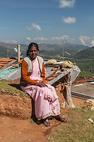 A woman sits on a hilltop near Ooty, India