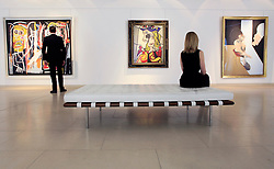 © Licensed to London News Pictures 10/04/2013.Christie's employees admire some of the world's most famous Abstract Expressionist paintings, on display at Christie's in central London, that are due to go on auction on 15th May in New York. .From left, Jean-Michel Basquiat's 'Dustheads' (estimated at $25,000,000 - $35,000,000); Roy Lichenstein's 'Woman with Flowereed Hat' (estimated at $30,000,000); Francis Bacon's 'Study for Portrait' (estimated at $18,000,000 - $25,000,000).London, UK.Photo credit: Anna Branthwaite