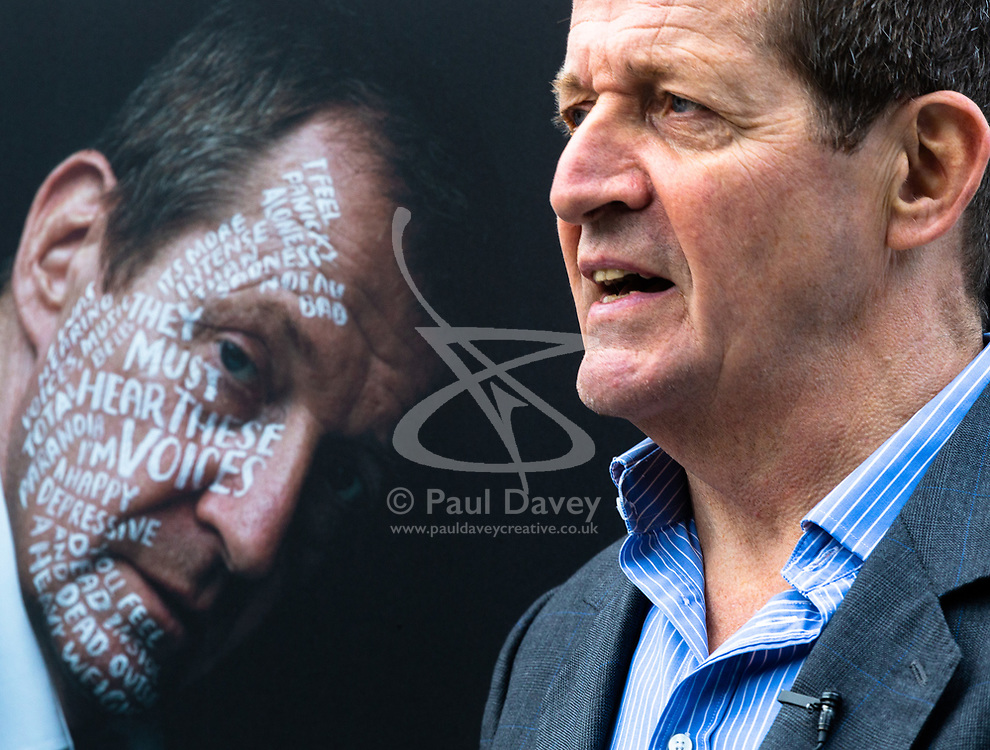 Alastair Campbell poses with his portrait at Let's Talk, a photography exhibition created in partnership with Mental Health UK At Regent's Place in London. It is designed to inspire open and honest conversations about mental health by depicting each subjects' inner battles on their faces. . Regents Place, Euston Road, London, October 08 2018.