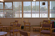 The visitors room at HMP Kingston, all the tables and chairs are fixed to the floor. Portsmouth, United Kingdom. Kingston prison is a category C prison holding indeterminate sentenced prisoners.