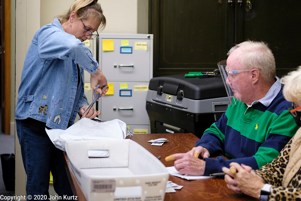 09 NOVEMBER 2020 - NEWTON, IOWA: TINA MULGREW, Deputy Auditor of Elections for Jasper County, opens the packages of ballots that need to be recounted. The Jasper County (Iowa) auditor ordered a manual recount of 561 votes from Clear Creek Poweshiek precinct in Mingo after vote totals were incorrectly transcribed on a spreadsheet. The incorrect vote total tabulation could affect the outcome of the election for Iowa's second congressional district. The incorrect transcription awarded more votes to Republican Congressional candidate Mariannette Miller-Meeks than she actually won and changed the outcome of the race. The corrected totals changed 162 votes and put Rita Hart, the Democratic candidate in the lead by 282 votes. The race is one of the closest races for a Congressional seat.      PHOTO BY JACK KURTZ