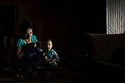 Srijana Phuyal and her 18 month-old daughter, Riya inside their home, Kakani, Nuwakot District, Nepal