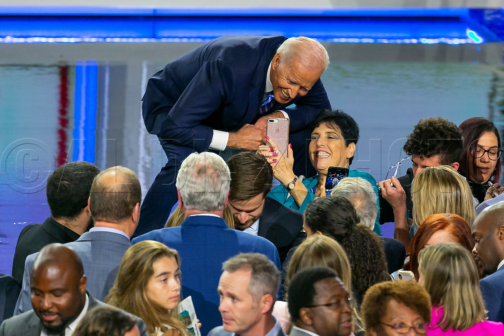 Democratic presidential candidate and former Vice President Joe Biden takes a selfie with an attendee at the conclusion of the first primary debate for the 2020 elections at the Adrienne Arsht Center for the Performing Arts in downtown Miami on Thursday, June 27, 2019.