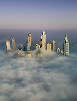 Aerial view of skyscrapers in the clouds of Dubai, U.A.E.