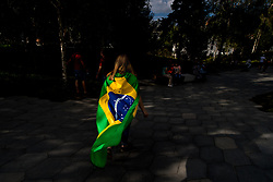 July 13, 2018 - Moscow, Russia - 180713 A fan of Brazil are seen walking in a park in central Moscow during the FIFA World Cup on July 13, 2018 in Moscow..Photo: Petter Arvidson / BILDBYRN / kod PA / 92086 (Credit Image: © Petter Arvidson/Bildbyran via ZUMA Press)