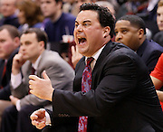 Arizona head coach Season Miller yells out to his players during the first half of an NCAA basketball game against BYU, Dec. 11, 2010 in Salt Lake City. (AP Photo/Colin E Braley)