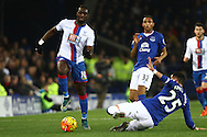 Ramiro Funes Mori of Everton (r) looks to tackle Yannick Bolasie of Crystal Palace. Barclays Premier league match, Everton v Crystal Palace at Goodison Park in Liverpool, Merseyside on Monday 7th December 2015.<br /> pic by Chris Stading, Andrew Orchard sports photography.