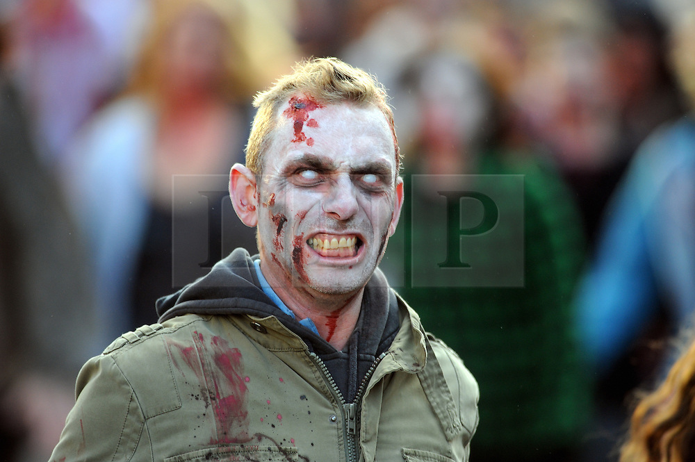 """© Licensed to London News Pictures. 15/09/2013<br /> Brentwood zombie movie """"Welcome to Essex""""<br /> The final shoot of  Welcome to Essex  has seen 1500 zombies running down Brentwood High Street this morning (15.09.2013) on the last day of filming for one of the biggest low-budget horror films.<br /> The film follows  Ryley Dunn played by Catherine Delaloye who after a drunken fall that lands her unconscious wakes up to find Brentwood over run with Zombies...<br /> Photo credit :Grant Falvey/LNP"""