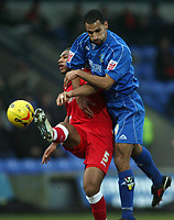 Photo: Paul Thomas.<br /> Macclesfield Town v Swindon Town. Coca Cola League 2. 23/12/2006.<br /> <br /> Ifil Jerel (L) of Swindon fights off Matty McNeil.