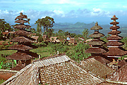 INDONESIA, BALI a rural village beyond the pagoda towers of the Basaki Temple, the mother temple  of all Balinese temples