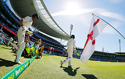England's Moeen Ali and Dawid Malan take the field during day two of the Ashes Test match at Sydney Cricket Ground.