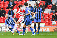 Mark Byrne of Gillingham (33) tackles John Marquis of Doncaster Rovers (9) during the EFL Sky Bet League 1 match between Doncaster Rovers and Gillingham at the Keepmoat Stadium, Doncaster, England on 20 October 2018.
