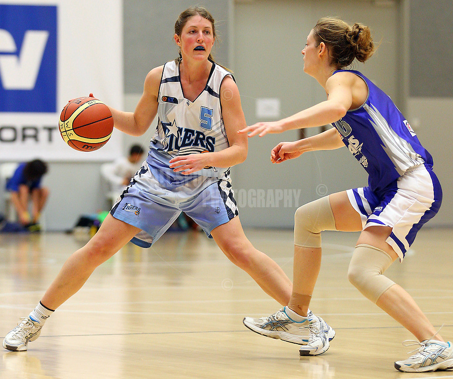 PERTH, AUSTRALIA - JULY 16: Jo Stear of the Tigers looks to drive past Belinda O'Halloran of the Hawks during the week 18 SBL game between the Perry Lakes Hawks and the Willetton TIgers at The State Basketball Center on July 16, 2011 in Perth, Australia.  (Photo by Paul Kane/All Sports Photography)