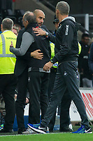 Football - 2016 /2017 Premier League - Swansea City vs Manchester City<br /> <br />  Swansea City manager Francesco Guidolin & Manchester City manager Pep Guardiola hug after the end of the game at the Liberty Stadium.<br /> <br /> <br /> PIC COLORSPORT/WINSTON BYNORTH