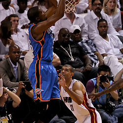 Jun 21, 2012; Miami, FL, USA; Oklahoma City Thunder small forward Kevin Durant (35) dunks over Miami Heat small forward Shane Battier (31) during the first quarter in game five in the 2012 NBA Finals at the American Airlines Arena. Mandatory Credit: Derick E. Hingle-US PRESSWIRE