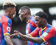 Jeffrey Schlupp (15) of Crystal Palace, celebrates after scoring goal with Patrick van Aanholt (3) of Crystal Palace,  during the Premier League match between Fulham and Crystal Palace at Craven Cottage, London, England on 11 August 2018.