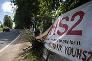 An anti-HS2 banner is displayed at Harvil Road protection camp opposite a construction site for the HS2 high-speed rail link on 29th July 2020 in Harefield, United Kingdom. Environmental activists based at a series of such camps have been attempting to disrupt the felling of many thousands of trees in the Colne Valley for the high-speed rail project.