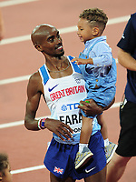 Athletics - 2017 IAAF London World Athletics Championships - Day One<br /> <br /> Mens 10,000m Mens Final<br /> <br /> Mohamed Farah (Great Britain) with his son over his shoulder after winning the race, at the London Stadium.<br /> <br /> COLORSPORT/ANDREW COWIE