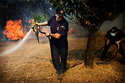 Firemen trying to control the fire  in maypia, Greece, on saturday, Sep. 1, 2007
