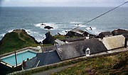 View out to Atlantic Ocean over hotel roof   which then had a swimming pool, Hartland Quay, north Devon coast, England, UK 1970s