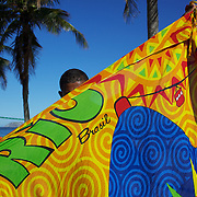 A local seller displays his merchandise for tourists at Copacabana beach, Rio de Janeiro, Brazil. 5th July 2010. Photo Tim Clayton..