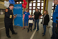Chief Ken Erickson welcomes Paul Swenson as an honorary member of the Laconia Fire Department during his swearing in ceremony on Sunday through the Make A Wish Foundation.  (l-r) Chief Ken Erickson, Vicki Swenson, Paul Swenson, Toni Mills Physical Therapist, Linda Thanas PSS Kindergarten Teacher and Grant Swenson.  (Karen Bobotas/for the Laconia Daily Sun)