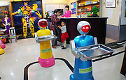 "HARBIN, CHINA - JUNE 07: (CHINA OUT) <br /> <br /> Two robot waiters deliver meals at Liu Hasheng Robot Restaurant on June 7, 2015 in Harbin, Heilongjiang province of China. A Haiying robot manufacturer in north China\'s Harbin Harbin Economic and Technological Development Zone has developed into a comprehensive company where multifunctional robots could be made out to work on the land, in water and air. Liu Hasheng, chief manager and founder of the robot manufacturer, opened the first conprehensive robots restaurant in China with ""waiters\"" produced by his own company. According to Liu Hasheng, those robot waiters have been sold out throught out country and his orders has also a great business opportunity in the future. <br /> ©Exclusivepix Media"