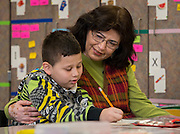 Angel Escobar-Larios poses for a photograph with his teacher at Lantrip Elementary School, February 12, 2015.