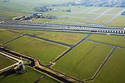 Nederland, Zuid-Holland, Hoogmade, 11-02-2008; kruising van de HSL met Rijksweg A4, de snelweg is reeds verbreed en gaat onder de spoorlijn door; .watermolen in de voorgrond, dorpskern Hoogmade in de achtergrond; drainage, sloten, veenweide landschap.viaduct, beton, transport, infrastructuur, mobiliteit, hogesnelheidslijn, spoor, rail, HSL, TGV, planologie, ruimtelijke ordening, landschap.luchtfoto (toeslag); aerial photo (additional fee required); .foto Siebe Swart / photo Siebe Swart
