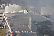 63818-02401 Firefighters extinguishing warehouse fire using aerial ladder truck viewed from top of ladder, Salem, IL