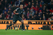 Vincent Kompany of Manchester City in action. Premier league match, Stoke City v Manchester City at the Bet365 Stadium in Stoke on Trent, Staffs on Monday 12th March 2018.<br /> pic by Andrew Orchard, Andrew Orchard sports photography.