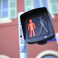 General View of a pedestrian stop sign.