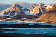 Sunset over the Hansbreen terminus and the peaks of Prinsessetoppen and Kamkrona, seen from the Polish Polar Station in Hornsund, Svalbard.