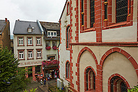 View of St Peter Church and Bacharach housing, with a cloudy sky and a street view, Bacharach, Germany.