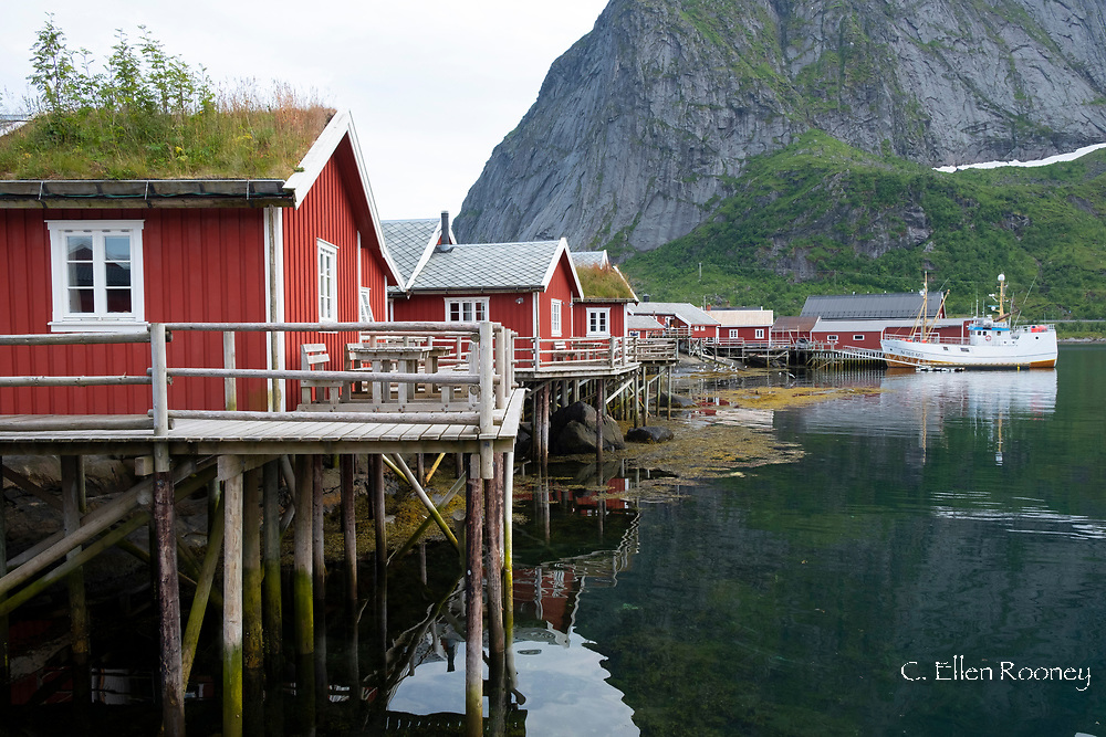 Rorbuer, traditional red timber fishermnen's cottages now used for tourist accommodaton in Reine, Moskenesoya, The Lofoten Islands, Norway