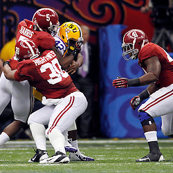 Jan 9, 2012; New Orleans, LA, USA; LSU Tigers running back Michael Ford (42) is tackled by Alabama Crimson Tide linebacker Dont'a Hightower (30) and Jerrell Harris (5) and Courtney Upshaw (41) during the second half of the 2012 BCS National Championship game at the Mercedes-Benz Superdome.  Mandatory Credit: Derick E. Hingle-US PRESSWIRE