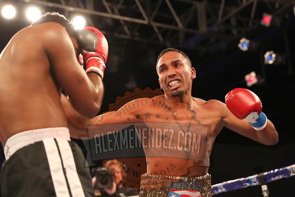 Gerald Semidy punches Yasmani Pedroso during a Telemundo boxing match at Osceola Heritage Park on Friday, July 20, 2018 in Kissimmee, Florida.  (Alex Menendez via AP)