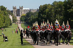 The Household Cavalry Mounted Regiment proceeds along the Long Walk towards Windsor Castle for a dress rehearsal for Trooping the Colour on 9th June 2021 in Windsor, United Kingdom. A socially distanced and scaled down Trooping the Colour ceremony to mark the Queen's birthday will take place at Windsor Castle on 12th June incorporating many of the elements from the annual ceremonial parade on Horse Guards, with F Company Scots Guards Trooping the Colour of the 2nd Battalion Scots Guards in the Castle Quadrangle.
