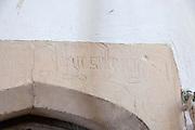 Carved name on stonework inside St Margaret South Elmham, Suffolk, England, UK