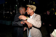 KANYE WEST; PHARRELL WILLIAMS, 2009 Serpentine Gallery Summer party. Sponsored by Canvas TV. Serpentine Gallery Pavilion designed by Kazuyo Sejima and Ryue Nishizawa of SANAA. Kensington Gdns. London. 9 July 2009.